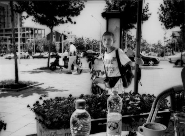 Albanian boy selling gum, lighters, etc., on the streets. Generally street vendors, such as this boy, are ethnically Albanian and not Roma. Tirana, Albania / 2009