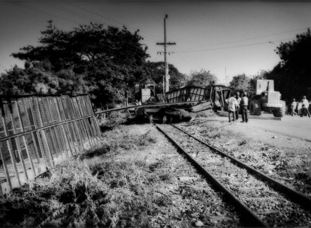 A collision between two of the continuously running trains which carry cut cane from the fields to the nearby sugar mill. One of these trains was sent out after repairs without a radio and in the ensuing collision several of the cars buckled and fell off the track. Barahona, Dominican Republic / 2009