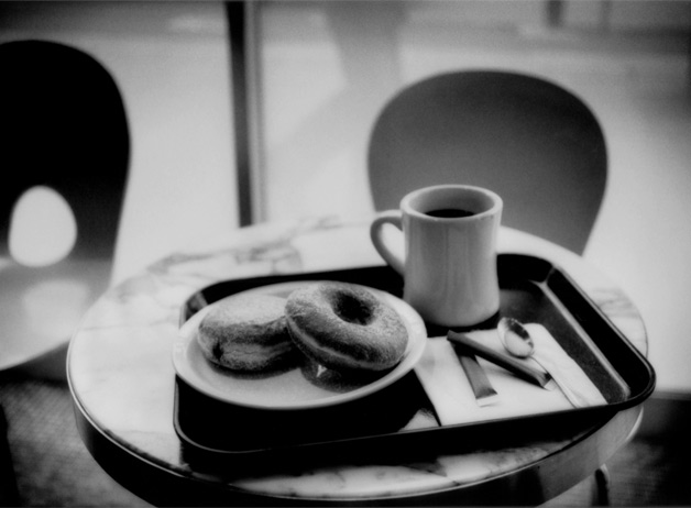 Sugar and jelly donuts, and cane sugar for coffee in a Tokyo cafe, Japan. The wholesale price of a ton of sugar used in making these products can be up to $500. A field worker is paid $2.50 per ton to cut the sugar cane. Tokyo, Japan / 2009