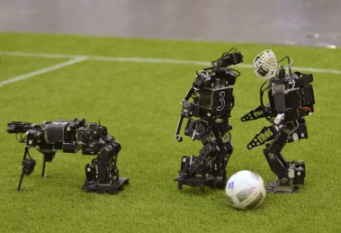 Humanoid robots compete during the 2015 Robocup in Hefei