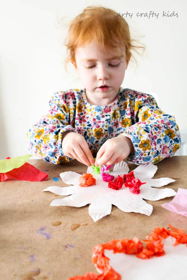 Arty Crafty Kids | Craft | Colourful Spring Paper Plate Flower Craft | A fun and simple Spring craft for kids. Toddlers and preschoolers will love the process of tearing, scrunching and sticking to make pretty paper plate flowers.