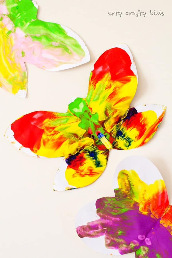 Arty Crafty Kids | Art | Easy Butterfly Kids Art | A butterfly twist on a classic process art project for kids. Sweet and simple for toddlers and preschoolers, a perfect Spring Craft for Kids!