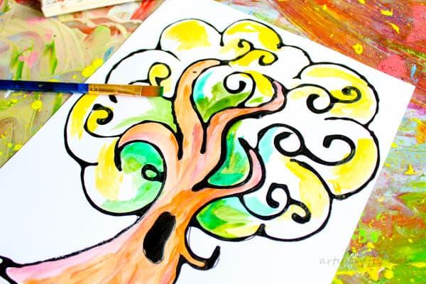 Arty Crafty Kids | Art | Autumn Crafts for Kids | Black Glue Autumn Tree Art | A beautiful Autumn art project for kids that explores autumn colors within a black glue resist medium. #Autumncraftsforkids #kidscrafts #falltrees #easyartideas