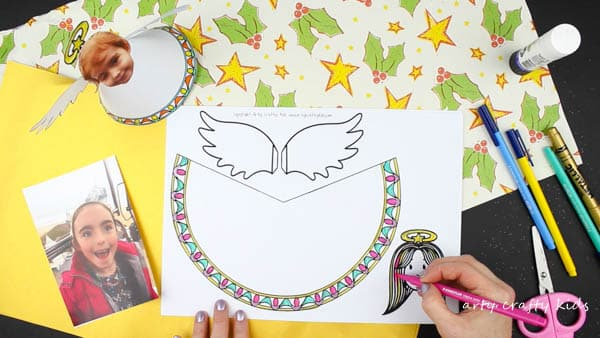 Arty Crafty Kids   Christmas Crafts for Kids   Adorable Paper Angel Christmas Ornamant for Kids, includes a free template for kids to design, colour and cut! #christmascraft #papercraft #christmascraftsforkids #christmasornament #freedownload