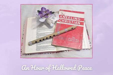 Picture of Bible open to the Lord's Prayer, book about prayer, purple flowers, and bamboo whistle