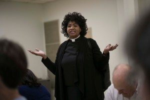 Picture of Rev. Dr. Carletta Allen saying Grace