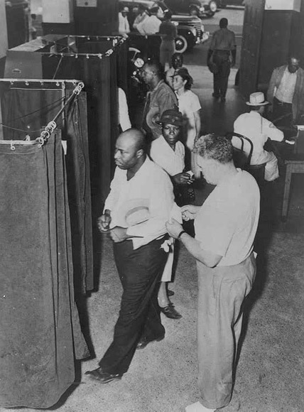 Voters at the voting booths in 1945