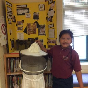 Ciara and her school project. Her central idea: Bees are important pollinators and we need them for our food supply.