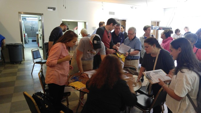 Canvassers gather around to get their packages