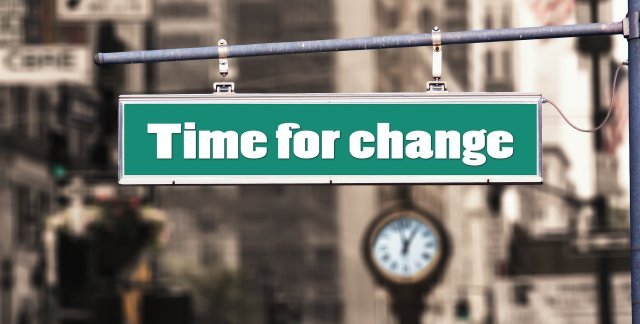 "Image of street post with the wording ""time for change."""