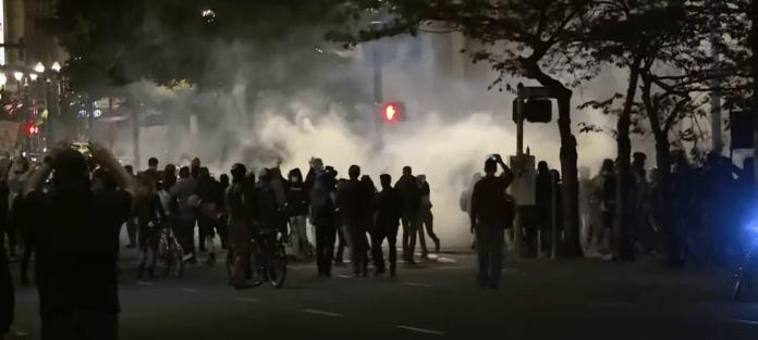 Police in riot gear teargas protestors