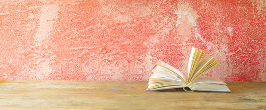open book on red grungy background, good copy space