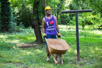 Student pushing wheelbarrow