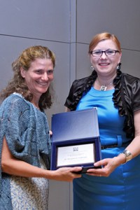 Dr. Marysia Galbraith, left, receives the Bronislaw Malinowski Social Sciences Award