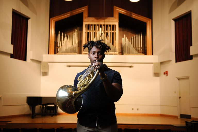 Joshua Williams playing the French horn