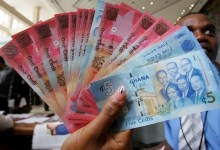 Photo of UPDATE 1-Ghana's cedi steadies as central bank steps up dollar-selling