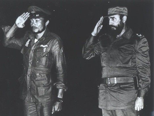 Jerry Rawlings takes salute with Fidel Castro