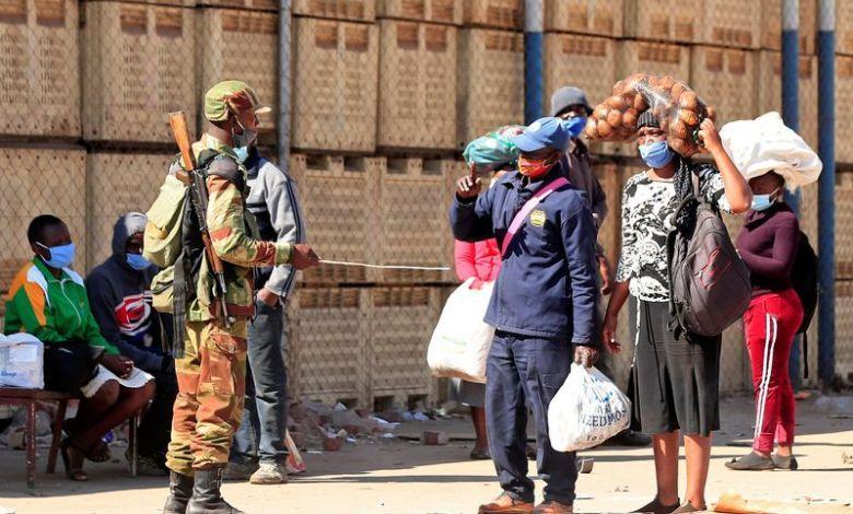 Security patrols check Zimbabwe pedestrians
