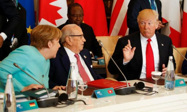 Trump talks to German Chancellor Merkel and Tunisia's President Essebsi at the G7 Summit expanded session in Taormina