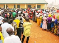 Voters Queue to Cast Their Votes in an Election
