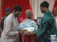 Delta State Governor, Senator Ifeanyi Okowa (left); receiving a gift from Royal Fathers, His Royal Majesty Emmanuel Efeizomor II, Obi of Owa (middle) and Benjamin Ikenchuku Keagborekuzi I, Dien of Agbor Kingdom, during a Meeting by the Governor on Traditional Rulers, at Owa Oyibu Delta State.