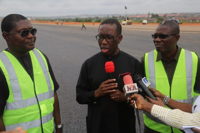 Delta State Governor, Senator Ifeanyi Okowa (middle); Commissioner for Works, Chief James Augoye(right) and Mr. Austin Ayemidejor, during the Governor's Inspection of the Rehabilitation of Runway and Taxiways, Extension of Box Culvert and Ancillary Works, at Asaba International Airport.