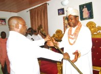 Delta Deputy Governor, Barr. Kingsley Otuaro Presenting Staff of Office to Chief Paul Ifenazuchie as Amai King