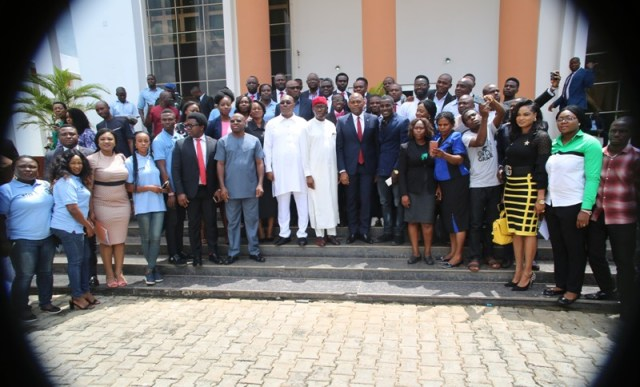 Delta State Governor, Senator Ifeanyi Okowa (on red hat); the Deputy Governor, Barr Kingsley Otuaro (on the right of the Governor), and the Founder of Tony Elumelu Foundation, Mr Tony Elumelu (left on the left of the Governor) in a group photograph with beneficiaries of Tony Elumelu Foundation, shortly after a courtesy call in Asaba.