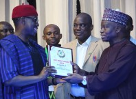 Delta State Governor, Senator Ifeanyi Okowa (left), receiving the National Olympic Committee Merit Award from it's President, Engr. Habu Gumel, during the NOC 2018 Merit Award night in Asaba.
