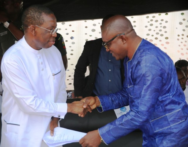 Delta State Governor, Senator Ifeanyi Okowa (left), and the Chairman/CEO. Juniuc  Nigeria Limited, Mr. Godwin Nonyalim, during the unveiling of the Governance Villa Housing Estate in Ibusa, Oshimili North LGA.