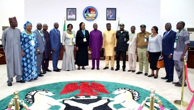 Delta State Governor, Senator Ifeanyi Okowa (8th left), in a group photograph with members of the Presidential Advisory Committee on Prerogative of Mercy during the Committee's courtesy call on the Governor in Asaba.