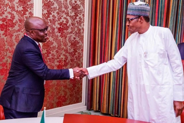 Dr. Emmanuel Uduaghan during a Visit to President Muhammadu Buhari at Aso Rock Villa