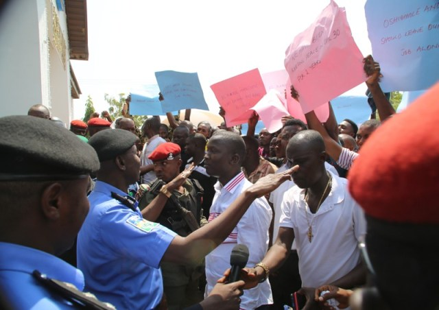 Delta State Commissioner for Police, Mr Muhammad Mustafa (2nd left), calming the protesters of Ijaw, Isoko, itsekiri and Urhobo Ethnic groups to Government House in Asaba.