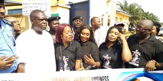 Civil Society Organizations Protesting Ritual Killing of Miss Elozino Ogege in Asaba led by Ambassador Caroline Usikpedo