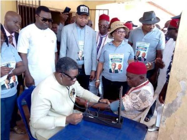Delta State Commissioner for Health, Dr. Mordi Ononye conducting blood pressure test on Onicha-Ugbo monarch, His Royal Majesty Agbogidi Victor Chukwumalieze