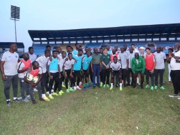Governor Okowa in a Group Photograph with Officials and Players of Super Eagles during the Inspection of their Training Camp, at Stephen Keshi Stadium, Asaba.