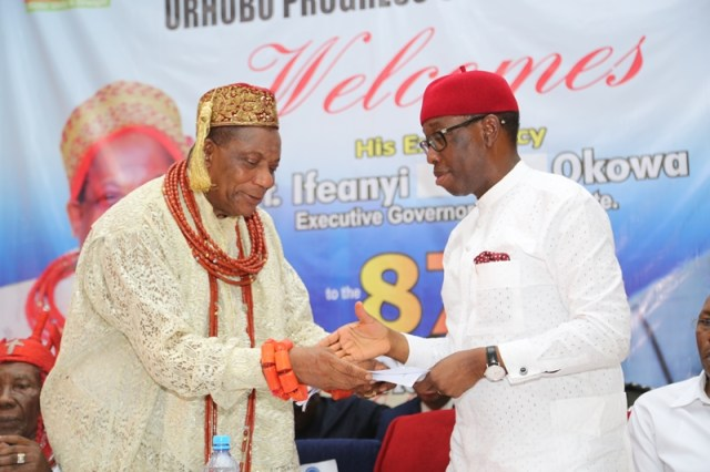 Delta State Governor, Senator Ifeanyi Okowa (right) receiving a letter of address from President General, Urhobo Progress Union (UPU) Worldwide, Olorogun Moses Taiga, during the 87th Annual National Congress and Awards of Honour/Carnival 2018, Organized by Urhobo Progress Union (UPU) Worldwide.