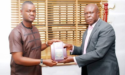 """The Delta State Commissioner, Ministry of Oil and Gas, Hon Freeman Orits Fregene receiving award of """"Outstanding Politician of the Year 2018"""" from the Publisher of Warri Voice Newspaper, Mr Femi Odonmeta"""