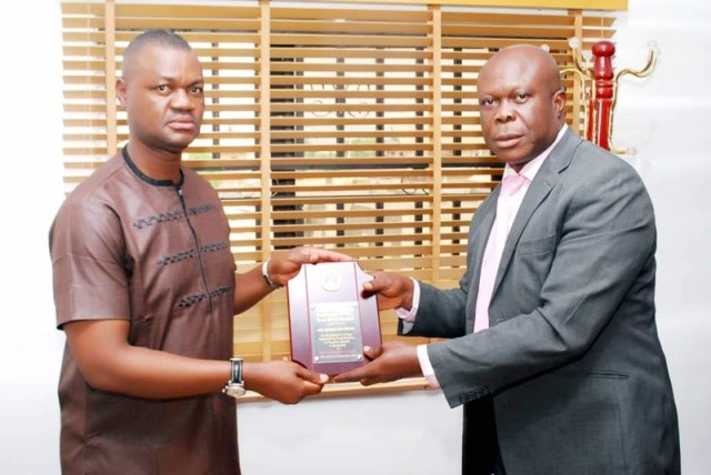 The Delta State Commissioner, Ministry of Oil and Gas, Hon Freeman Orits Fregene receiving award of