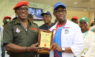 Delta State Governor, Senator Ifeanyi Okowa (right) receiving a Special Honors Award for Promoting Track and Field Athletics in the African Continent from Hon. Minister of Sport, Solomon Dalung, at the 2018, 19th National Sport Festival held in Abuja.
