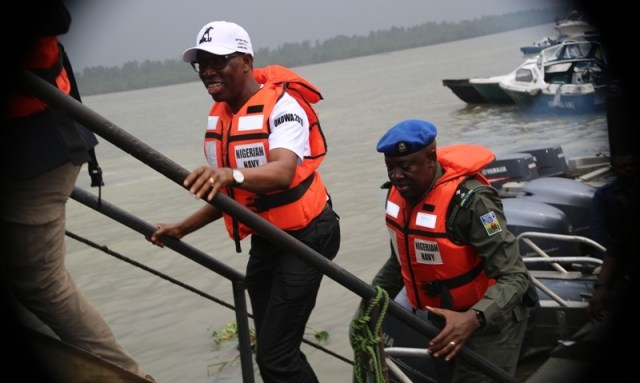 Delta State Governor, Senator Ifeanyi Okowa alighting from Military boat during the Party 2019 General Elections campaign at Burutu LGA