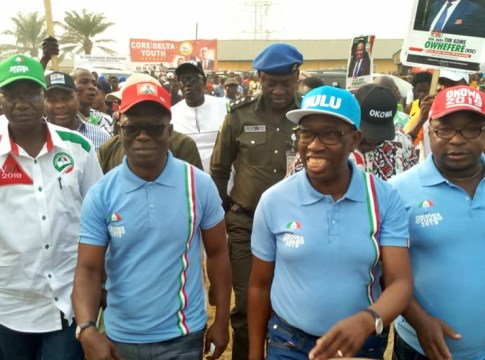 Delta State Governor, Senator Ifeanyi Okowa (2nd right), former Secretary to Delta State Government, Comrade Ovuozourie Macaulay acknowledging cheers from PDP faithfuls during the Campaign rally in Ozoro, Isoko North Local Council. PIX: GOODLUCK EMEOFAGBE