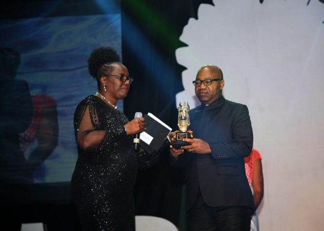 Secretary to State Government, Hon. Ovie Agas (right), receiving the Award of Outstanding Governor of Year, Job Creation, form Mrs. Tosi Dokpesi, on behalf of Delta State Governor, Senator Ifeanyi Okowa, during the 3rd DAAR Communication Award Night, at International Conference Center, Abuja.