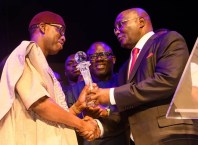 PDP Presidential Candidate, Alhaji Atiku Abubakar (right) presenting the 2018 Silverbird Man of the Year Award to Delta State Governor, Senator Ifeanyi Okowa, at 2018 Man of the Year Awards.
