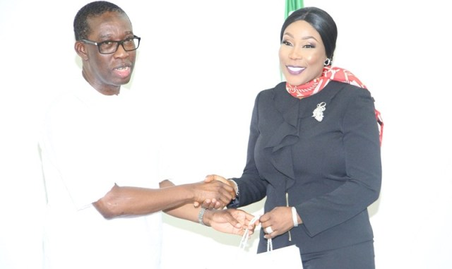 Delta State Governor, Senator Ifeanyi Okowa (left) and the Director General of NAPTIP, Dame Julie Okah-Donli, during a courtesy call on the governor, in government house Asaba.