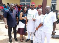 Hon Emeka Nwaobi (middle) flanked by spouse and Aniocha North PDP Leaders after receiving his INEC Certificate of return