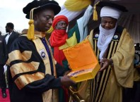 Ned Nwoko (left) Receives Doctorate Award From FUPRE