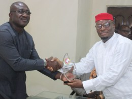 L-R: Chief Patrick Ukah receiving Award from Anioma Media Associates being Presented by the National Coordinator, Prince David Diai