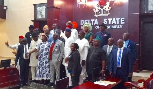 Speaker Sheriff Oborevwori flanked by Lawmakers of the Sixth Assembly of the Delta State House of Assembly