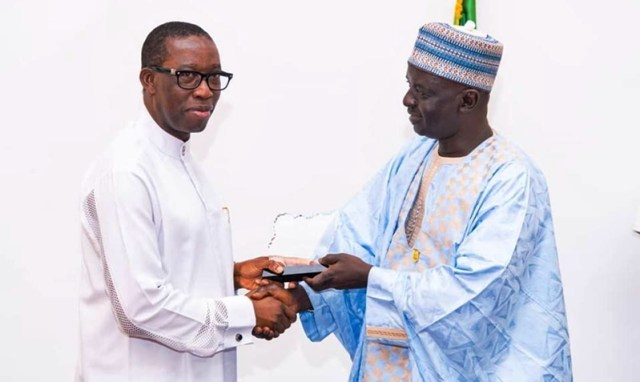 Delta State Governor, Senator Ifeanyi Okowa (left), presenting a souvenir to the Acting Director General of the National Institute and Strategic Studies Kuru, Jonathan Juma MNI during a courtesy call by the Participants of the Senior Executive Course 41 of NIPSS on the Governor in Asaba.
